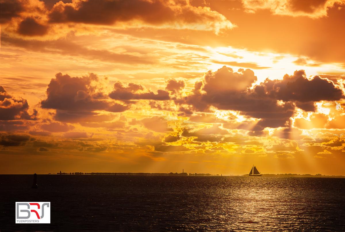 Holwerd Zonsondergang met Zeilboot